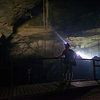 A man with a head torch in Miri Caves, Miri, Sarawak, Malaysia, Borneo,
