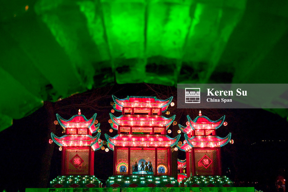 Illuminated ice sculpture of traditional architecture at Ice Festival in Harbin, Heilongjiang Province, China