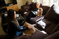Co-founders of Save Porter Ranch Kyoko Hibino and Matt Pakucko, right, sit on their couch with their cats during a tour of their home as methane gas leaks from the SoCalGas Aliso Canyon Storage Facility well SS-25 in the Porter Ranch neighborhood of Los Angeles, California on Wednesday, December 30, 2015. The Aliso Canyon gas leak (also called Porter Ranch gas leak) was a massive natural gas leak that started on October 23, 2015. According to Wikipedia, an estimated 1,000,000 barrels per day was released from a well within the underground storage facility in the Santa Susana Mountains near Porter Ranch. The second-largest gas storage facility it belongs to the Southern California Gas Company (SoCalGas), a subsidiary of Sempra Energy. On Jan. 6, 2016, Governor Jerry Brown issued a State of Emergency. The Aliso gas leak carbon footprint is said to be larger than the Deepwater Horizon leak in the Gulf of Mexico. On Feb. 11, 2016 the gas company reported that it had the leak under control. On Feb. 18 state officials announced that the leak was permanently plugged. An estimated 97,100 tonnes of methane and 7,300 tonnes of ethane was released into the atmosphere, making it the worst natural gas leak in U.S. history in terms of its environmental impact. © 2015 Patrick T. Fallon