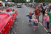 Run for the bubbles: Kids try to get the bubbles made by a woman in the Joyce Daze Parade, in Joyce WA. Joyce is a small town about 15 miles west of Port Angeles, WA.