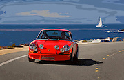 Image of a 1972 Porsche 911 on a curvy road in Monterey, California, America west coast, model and property released
