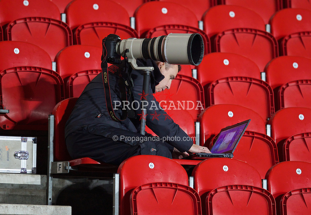 ST. HELENS, ENGLAND - Wednesday, January 15, 2014: Press Association photographer Peter Byrne during the FA Youth Cup 4th Round match at Langtree Park. (Pic by David Rawcliffe/Propaganda)