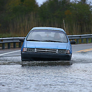 10/30/12 - Smyrna, DE - Hurricane Sandy - Motorist drive carefully on flooded woodland beach road Tuesday, Oct. 30, 2012, in Smyrna DE. ..SAQUAN STIMPSON/Special to The News Journal