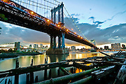 View of Manhattan bridge at sunset from DUMBO, with the remains of an old dock, Brooklyn, New York, 2010.