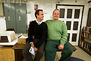 """Max Kenner (left) with inmate and Bard College graduate Bill Doane (55) in the computer room at Woodbourne Correctional Facility. Max is the brainchild behind the privately funded Bard College  Initiative for prison inmates. Bill, who graduated from Bard in 2008, was sentenced to 24 years in prison...Story: The Bard Prison Initiative.Former inmate Carlos Rosario, 35-year-old husband and father of four, was released from Woodbourne Correctional Facility after serving more than 12 years for armed robbery. Rosado is one of the students participating in the Bard Prison Initiative, a privately-funded program that offers inmates at five New York State prisons the opportunity to work toward a college degree from Bard College. The program, which is the brainchild of alumnus Max Kenner, is competitive, accepting only 15 new students at each facility every other year. .Carlos Rosario received the Bachelor of Arts degree in social studies from the prestigious College Saturday, just a few days after his release. He had been working on it for the last six years. His senior thesis was titled """"The Diet of Punishment: Prison Food and Penal Practice in the Post-Rehabilitative Era,"""".Rosado is credited with developing a garden in one of the few green spaces inside the otherwise cement-heavy prison. In the two years since the garden's foundation, it has provided some of the only access the prison's 800 inmates have to fresh vegetables and fruit...Rosario now works for a recycling company in Poughkeepsie, N.Y...Photo © Stefan Falke"""