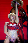 Miley Cyrus performs live on stage at 02 Arena on May 6, 2014 in London, England.  (Photo by Simone Joyner)