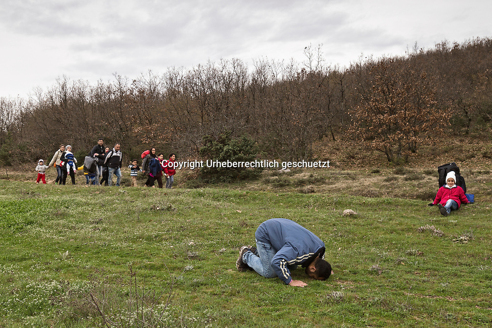 Greece, Idomeni, Refugees on their way to Europe,   March of Hope<br /> <br /> Refugees from Syria, Irak, Afghanistan and others from the near east are trying to reach the border between Greece and Macedonia (FYROM), they had to cross the small river Suva Reka, near the village Hamilo. <br /> <br /> On there way to the border a man is praying on the wild medow. Other refugees trying to reach the border.<br /> <br /> Nadeloehr nach Nordeuropa Idomeni, der Grenzuebergang ist seit Tagen gesperrt,. <br /> Es ensteht im provisorischen Fluechtlingslager in Idomeni eine ngespannte Lage. <br /> Regen und Kaelte machen vor allem den Familien mit kleinen Kindern zu schaffen. <br /> <br /> Idomeni, is the eye of a needle for getting to nothern Europe. <br /> The FYRO macedonian authorities, closed the border from Greece completely. The situation close to the border gets more and more difficult. The People have to sleep outside or in small tents. <br /> Heavy rainfalls and cold nights are treating the refugees badly. Some already stayed up to ten nights at Idomeni. There is not enough food and supplies to help about 14.000 refugees<br /> <br /> <br /> keine Veroeffentlichung unter 50 Euro*** Bitte auf moegliche weitere Vermerke achten***Maximale Online-Nutzungsdauer: 12 Monate !! <br /> <br /> for international use:<br /> Murat Tueremis<br /> C O M M E R Z  B A N K   A G , C o l o g n e ,  G e r m a n y<br /> IBAN: DE 04 370 800 40 033 99 679 00<br /> SWIFT-BIC: COBADEFFXXX