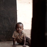 Young boy in a doorway in Delo Mena, Ethiopia