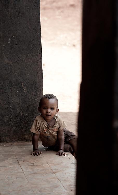 Young boy in a doorway in Delo Mena, Ethiopia