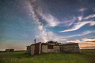 The summer Milky Way over the cabin once lived in by the legendary western writer Will James, on the Larson Ranch in the Frenchman River Valley in Grasslands National Park, Saskatchewan. Mars, Saturn and Antares are just above the cabin roof at right. Taken August 8, 2016. Grasslands is a Dark Sky Preserve. There are no lights visible from the Park and little sky glow illuminating the sky from distant lights. This was shot with the last bit of twilight illuminating the sky. The frames were part of an aborted time-lapse sequence hit by dew on the lens. <br /> <br /> This is a stack of 7 exposures for the ground to smooth noise and one exposure for the sky, all untracked, and all 30 seconds at f/2.8 with the 14mm Rokinon lens and Canon 6D at ISO 6400.