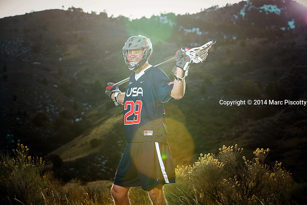 SHOT 2/22/14 4:52:18 PM - Denver Outlaws and Team USA defenseman Lee Zink poses for a portrait with Red Rocks and the foothills just outside of Denver, Co. in the background. Zink was named the 2012 Major League Lacrosse Defensive Player of the Year. When Zink grew up in Darien, Conn., and started his lacrosse career in sixth grade, he knew defense would be his calling card from the beginning. Zink will be playing in Denver this summer in the 2014 FIL World Lacrosse Championships.<br /> (Photo by Marc Piscotty / &copy; 2014)