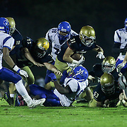 Salesianum Running Back Zachary Jarome (31) dives for extra yards in the third quarter Friday, Oct. 09, 2015 at Bernard Stadium in Wilmington, DE.