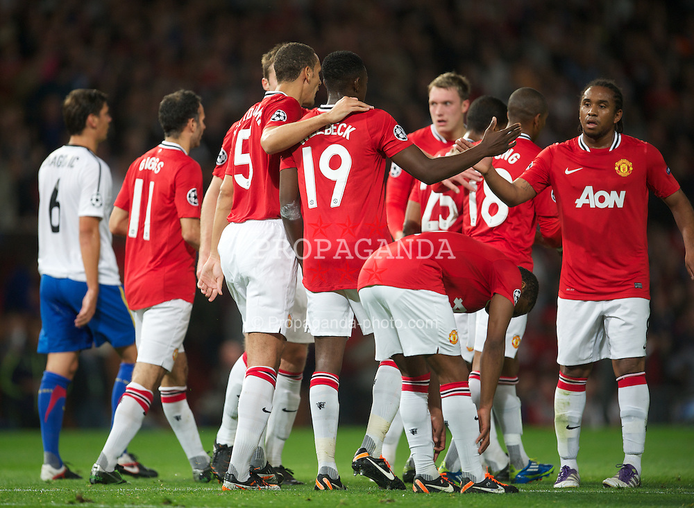 MANCHESTER, ENGLAND - Tuesday, September 27, 2011: Manchester United's Danny Welbeck celebrates scoring the first goal against FC Basel 1893 with team-mate Phil Jones during the UEFA Champions League Group C match at Old Trafford. (Pic by David Rawcliffe/Propaganda)