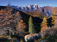 """I took this an evening of mid October, when fall colours were just about the peak, from atop the ridge that encircles the lake of Arpy (which lies behind my shoulders here), a natural balcony looking down to the north-western end of Valle d'Aosta, with the majestic Monte Bianco massif in the background...The title comes from the Austrian composer Joseph Marx's masterpiece """"Eine Herbstsinfonie"""", a piece that I love and which I immediately thought of when I spotted this scene. A true symphony of colours and mountain ranges in this vista..This is stitched from 5 vertical frames"""