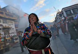 A picture made available on 19 September 2016 of Tibetan pilgrims praying outside the Jokhang Temple in the early morning in Lhasa, Tibet Autonomous Region, China, 10 September 2016. Jokhang Temple is considered one of the most sacred site for Tibetan buddhists built during the rule of King Songtsen Gampo in the 7th century.