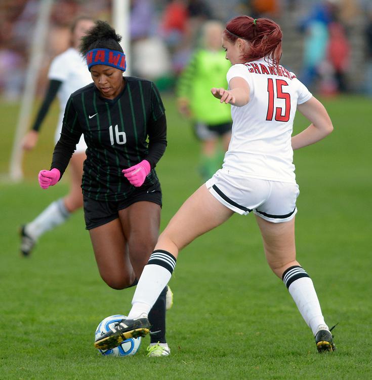 gbs110416j/SPORTS -- Farmington's  Ha'teya Holloman, 16, and Academy's Annie Spahn, 15, tangle during the 5A Girl's State Soccer semifinal game on Friday, November 4, 2016. (Greg Sorber/Albuquerque Journal)