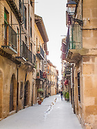 One of the main streets in the ancient walled city of La Guardia, Spain