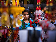"18 JANUARY 2017 - BANGKOK, THAILAND: People shop for Chinese New Year supplies in Bangkok's Chinatown district. Chinese New Year, also called Lunar New Year or Tet (in Vietnamese communities) starts Saturday, 28 January. The coming year will be the ""Year of the Rooster."" Thailand has the largest overseas Chinese population in the world; about 14 percent of Thais are of Chinese ancestry and some Chinese holidays, especially Chinese New Year, are widely celebrated in Thailand.       PHOTO BY JACK KURTZ"