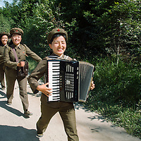 Group of soldiers, marching and playing music