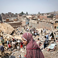 A young girl looks on as hundreds of people search for survivors after a rockslide hit a Cairo shanty town. Twenty people were killed and hundreds more missing when a massive rockslide hit a crowded Cairo shanty town on Saturday, sending rocks and boulders crashing down on dozens of houses. September 2008.