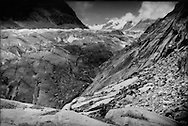The Great Aletsch Glacier grinds past stone that funnels it down the valley widening the valley at a location known for the regular appearance of a potentially dangerous ice-dammed Lake Marjelen, which filled this space as recently as last year.  When the ice dam breaks, devastating floods have occured down the valley in Naters and Brig, though the last severe flood was almost 100 years ago in 1915.