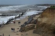 Coastal Erosion, Happisburgh on the North Norfolk coast, Britain. Managed retreat is being allowed to happen at many locations on the coast of Britain. Here at Happisburgh, looking South, the North Sea has destroyed all sea defences-seen here-, the land has been eroded away by wind and sea and homes, property and WW2 gun emplacements have fallen onto the beach from the crumbling cliff edge..COPYRIGHT PHOTOGRAPH BY BRIAN HARRIS  © 2008.07808-579804