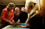 Karolina Vasyanovych, 15 (second on the left) and her sisters try to figure out in the Map at what distance from each other they will be during Summer holidays. She goes to Portugal since 2014 and some of her 10 brothers and sisters go to Spain to similar programs. Her mother is unemployed and her father works on a farm. She wants to become a teacher.
