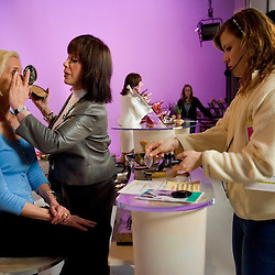 SPECIAL TO THE PALM BEACH POST---Adrienne Arpel apllies makeup to a model as broadcast personnel restock the set for the net product during a live show for Arpel's Signature A cosmetics on Friday, March 18, 2005 in St. Petersburg, Fla. (AP Photo/Scott Audette)