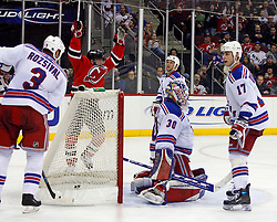February 1, 2008; Newark, NJ, USA; New Jersey Devils center John Madden (11) celebrates a goal by New Jersey Devils left wing Zach Parise (9) during the second period at the Prudential Center in Newark, NJ.