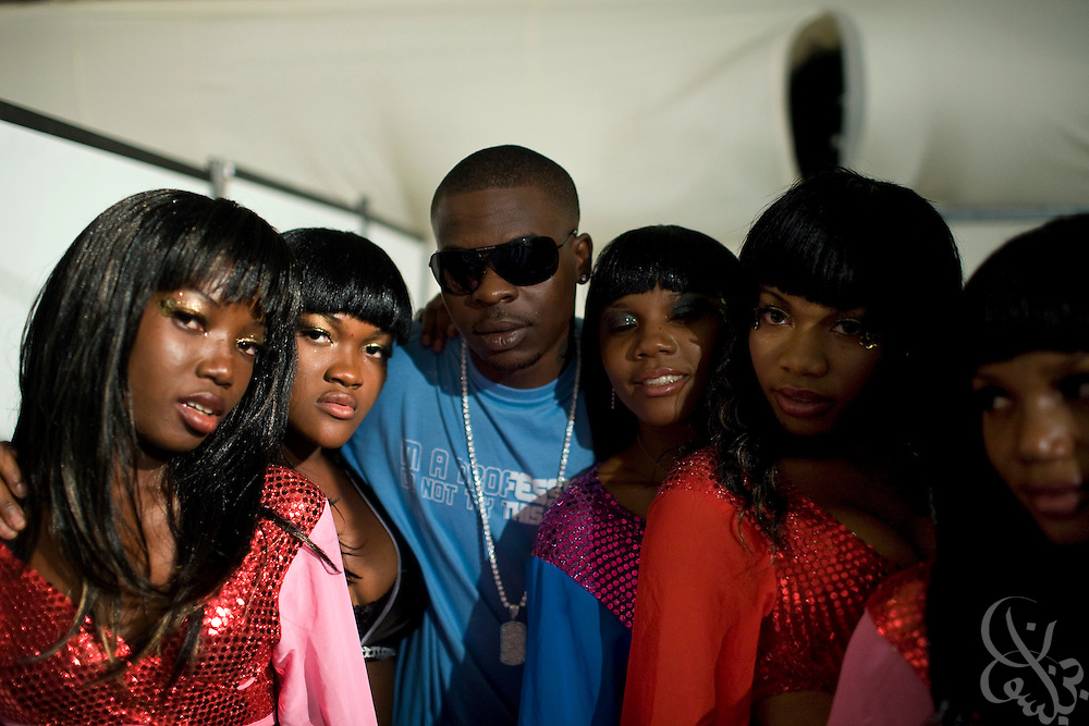 "Nigerian hip hop/R&B artist Shank (C, blue) waits backstage to perform along with his dancers during the ThisDay festival July 13, 2008 in Lagos, Nigeria. The festival, themed ""Africa Rising"", aims to raise awareness of African issues while promoting positive images of Africa using music, fashion and culture in a series of concerts and events in Nigeria, the United States and the United Kingdom. ."