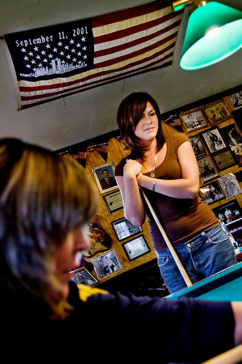 Ashley Mallow playing pool at the Trubadour bar and country music venue in West Virginia...Photographer: Chris Maluszynski /MOMENT
