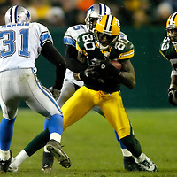 Green Bay's Donald Driver for a 14-yard catch to the Detroit 47-yard line in the 3rd quarter. Driver was tackled by Detroit's Andre' Goodman. .The Green Bay Packers hosted the Detroit Lions at Lambeau Field Sunday, December 12, 2004. WSJ/Steve Apps.