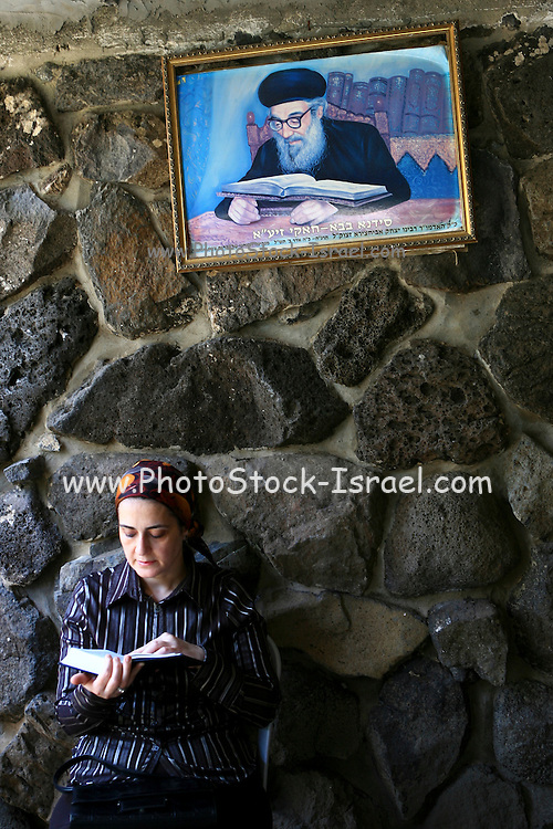 Israel, Galilee, Tiberias, Jewish woman prays at the tomb of the Rambam (Moshes Maimondies, or Rabbi Shimon ben Mimon) People come from all over to pray at this site as they attribute special abilities to this holy place