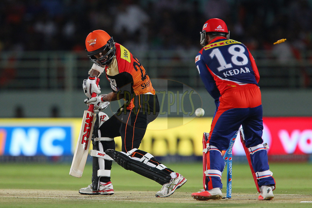 Shikhar Dhawan of the Sunrisers Hyderabad looks back as he is bowled by Jean-Paul Duminy captain of the Delhi Daredevils  during match 13 of the Pepsi IPL 2015 (Indian Premier League) between The Sunrisers Hyderabad and The Delhi Daredevils held at the ACA-VDCA Stadium in Visakhapatnam India on the 18th April 2015.<br /> <br /> Photo by:  Ron Gaunt / SPORTZPICS / IPL