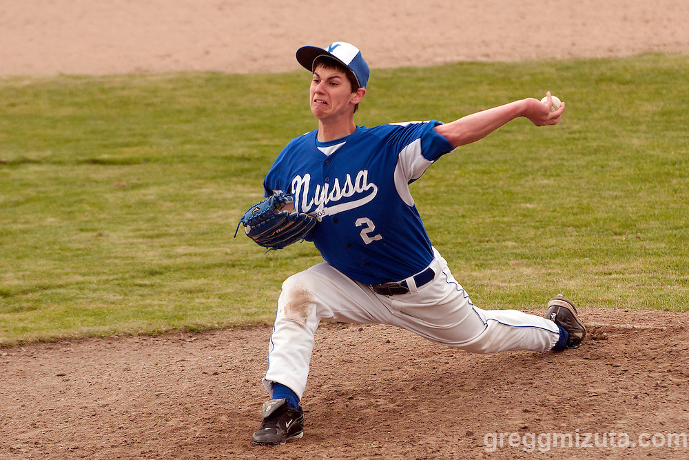 Nyssa's Alec Blanchard delivers a pitch during the second game of a doubleheader between Vale and Nyssa on April 15, 2011 at Nyssa High School. Blanchard struck out eight of the first nine batters he faced but gave up a solo home run to Kyle Barras in the fourth and five runs in the fifth in a 6-1 loss to Vale.