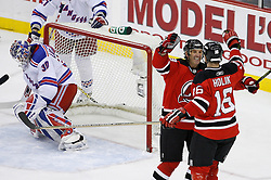 Feb 9, 2009; Newark, NJ, USA; New Jersey Devils left wing Brendan Shanahan (18) and New Jersey Devils center Bobby Holik (16) celebrate Holik's goal during the second period at the Prudential Center.