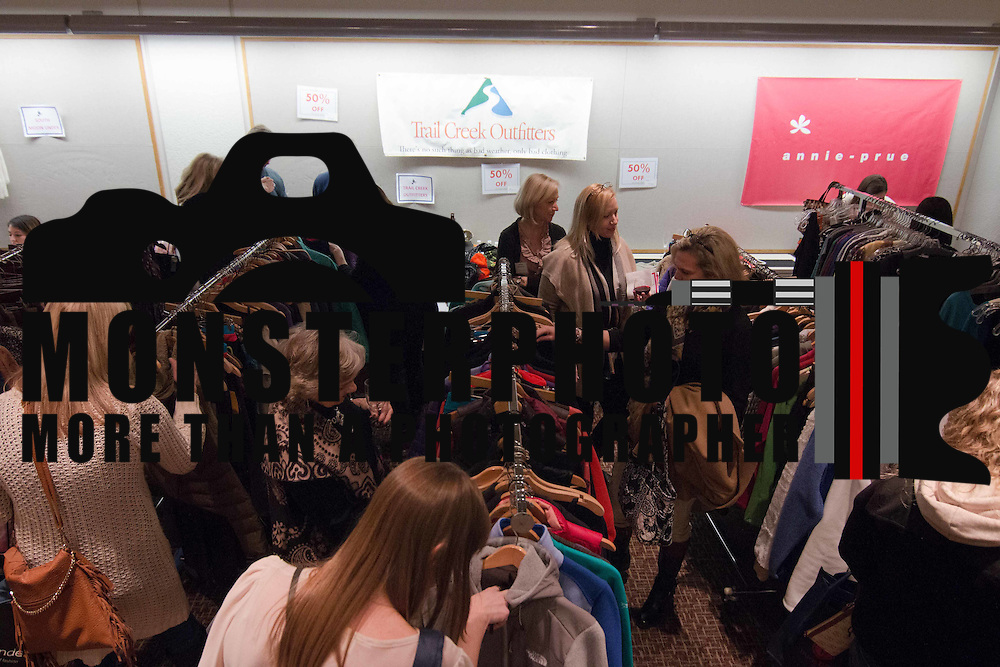 Shoppers browse though racks of fashions at the Trail Creek Outfitters booth during the 3rd Annual Guilty Girls Warehouse Sale Friday, Feb. 06, 2015 at University of Delaware's Arsht Hall in Wilmington, DE.