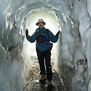 An ice tunnel exits to climbing routes from Aiguille du Midi (12,600 feet), a station on the téléphérique (cable car, aerial tramway) from Chamonix, France, the Alps, Europe. For licensing options, please inquire.