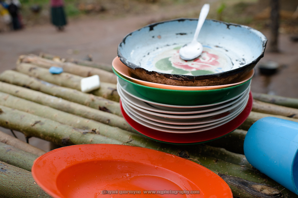 Dishes at the home of Margaret Kigeni (14) on 1 August 2014. She is a student at Achilet Primary School in the Eastern Region of Uganda, and an Afripads customer—her school particpates in Menstural Hygiene Management activities.