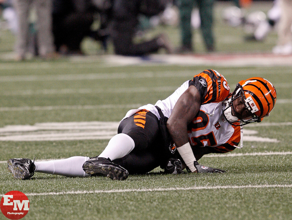 Jan 3, 2010; East Rutherford, NJ, USA; Cincinnati Bengals wide receiver Chad Ochocinco (85) slips on the icey turf during the pregame warmups before their game against the New York Jets at Giants Stadium. Ochocinco came up limping after the fall.