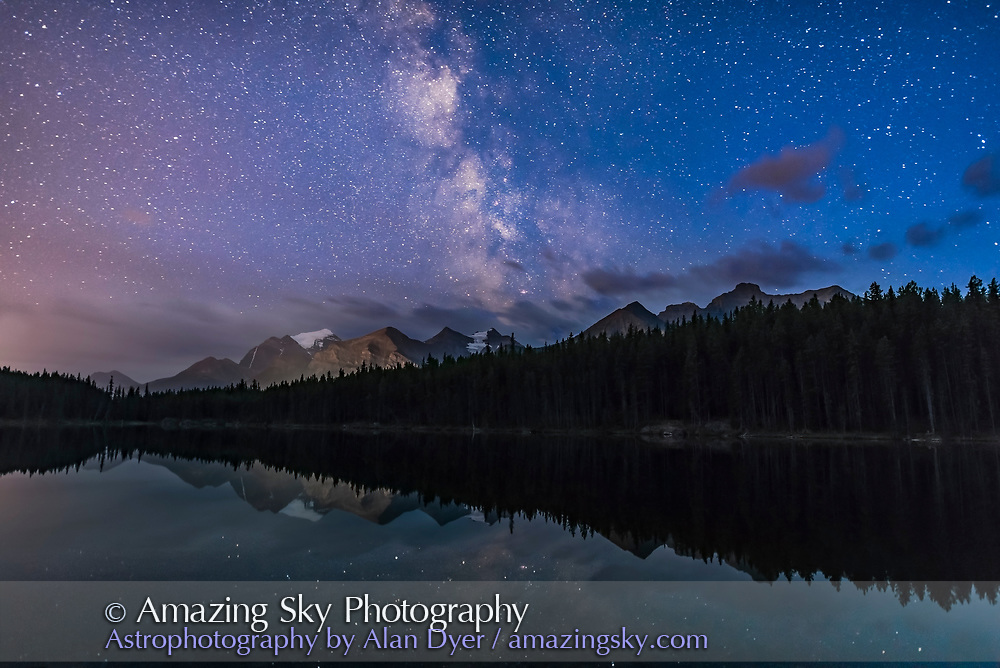 The Milky Way set in the deep blue of evening twilight, over Herbert Lake and Mount Temple and peaks around Lake Louise, in Banff National Park, Alberta. Taken August 29, 2016. <br /> <br /> This is a stack of 10 images for the ground, mean averaged to smooth noise, and one image for the ground and lake reflections to minimize star trailing. All are 25 seconds at f/2 with the Sigma 20mm Art lens and Nikon D750 at ISO 3200.