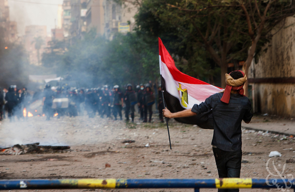 Egyptian security forces fire rubber bullets, buckshot and tear gas at protestors during demonstrations November 21, 2011 near Tahrir square  in central Cairo, Egypt. Thousands of protestors demanding the military cede power to a civilian government authority clashed with Egyptian security forces for a third straight day in Cairo, with hundreds injured and at least 24 protestors killed.  (Photo by Scott Nelson)