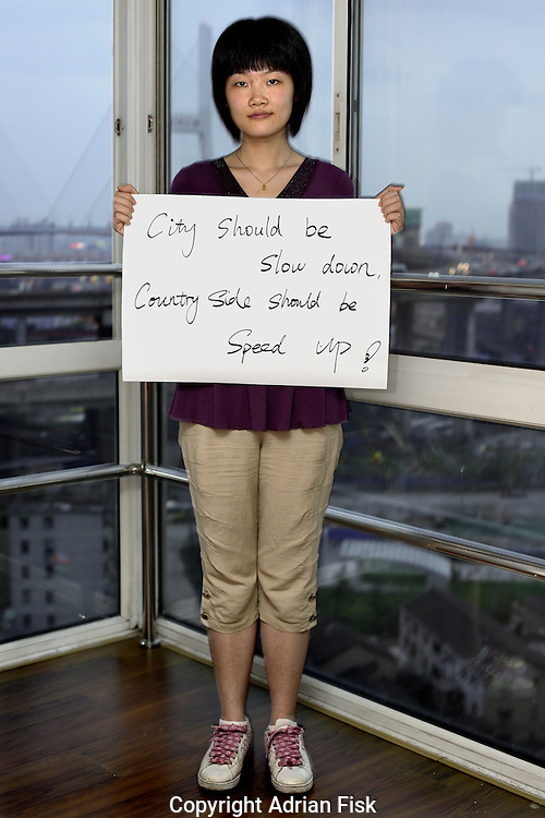 Guan Ying Ni - 25 Yrs.<br /> Computer systems analyst.<br /> Shanghai.<br /> <br /> 'City should be slow down, countryside should be speed up'.