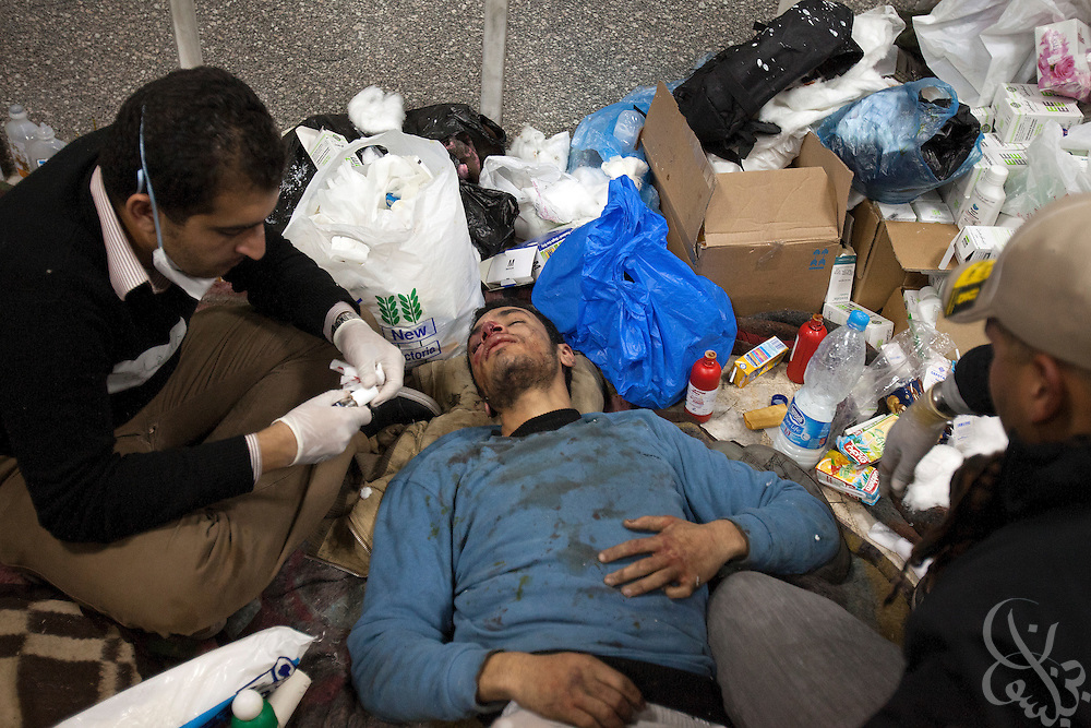 A wounded Egyptian protestor is treated inside the Tahrir Square field hospital during ongoing demonstrations November 20, 2011 near Tahrir square in central Cairo, Egypt.  Protestors demanding the transition of power from military to civilian control clashed with Egyptian security forces for a second straight day in central Cairo, with hundreds injured and at least 11 protestors killed.  (Photo by Scott Nelson)