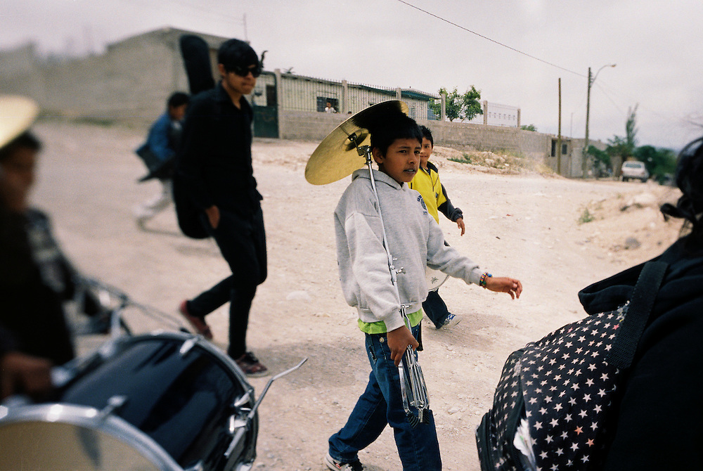 Members of the Toke Azul Band and their friends walk home after a performance in the Diaz Ordaz colonia in Ciudad Juarez, Chihuahua Mexico on April 29, 2010. .
