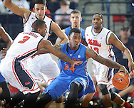 "Florida's Casey Prather (24) is defended by Mississippi's Derrick Millinghaus (3) and Mississippi's Sebastian Saiz (11) at the C.M. ""Tad"" Smith Coliseum in Oxford, Miss. on Saturday, February 22, 2014. (AP Photo/Oxford Eagle, Bruce Newman)"