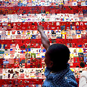 Buckman Elementary School 4th grader Gibson Franscios checks out his artwork as part of the AT&T Broadband Freedom Flag. It is displayed at the Pioneer Place Mall and is made up of drawingsdesigned by 1,034 students including those from Buckman.