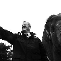"""(Mendon, MA - 6/28/15) Gov. Charlie Baker takes a selfie with Asian elephant Rosie during the 50th anniversary """"Golden Zoobilation"""" celebration at Southwick's Zoo, Sunday, June 28, 2015. Staff photo by Angela Rowlings."""