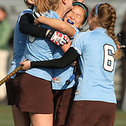 11/02/2012- Geneva, New York - Teammates rush to congratulate Tufts forward Hannah Park, A16, after she scored against Montclair State in the NCAA Division III Field Hockey Championship game at William Smith College on Nov. 18, 2012. Tufts won, 2-1, to win the National Championship. (Michael Okoniewski for Tufts University)