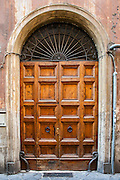Wooden apartmenthouse door, Rome, Italy